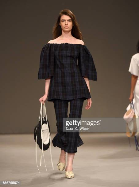 A model walks the runway during the Eudon Choi show at Fashion Forward October 2017 held at the Dubai Design District on October 26 2017 in Dubai...