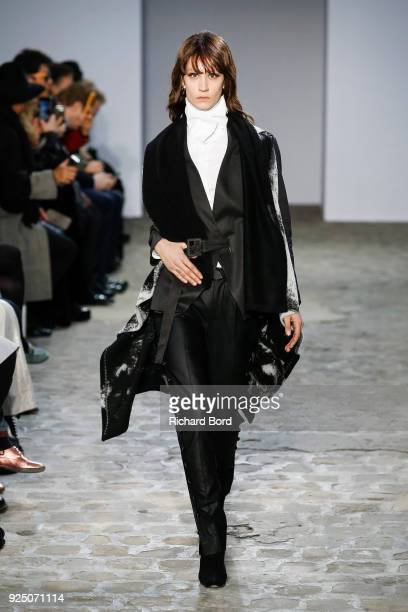 A model walks the runway during the Fashion Farm Foundation show as part of the Paris Fashion Week Womenswear Fall/Winter 2018/2019 on February 27...