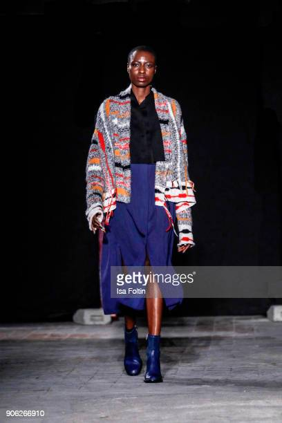 A model walks the runway during the Fashion HAB show presented by MercedesBenz at Halle am Berghain on January 17 2018 in Berlin Germany