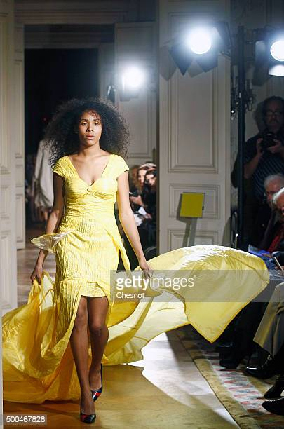 A model walks the runway during the fashion show 'Changer La Mode Pour Le Climat' as part of 21st session of Conference on climate change COP21 at...