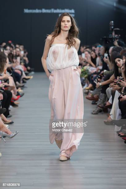 A model walks the runway during the Fashion Week Academy show at Mercedes Benz Fashion Week Mexico Spring/Summer 2018 at Altto San Angel on November...
