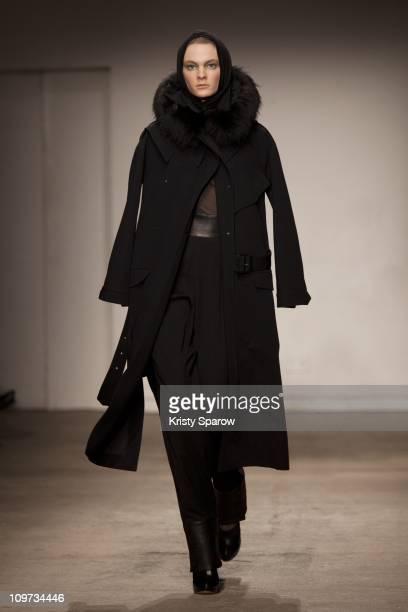 A model walks the runway during the Felipe Oliveira Baptista Ready to Wear Autumn/Winter 2011/2012 show during Paris Fashion Week at Palais De Tokyo...