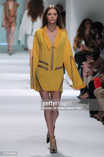 Model walks the runway during the Felipe Oliveira Baptista Ready to Wear Spring / Summer 2012 show during Paris Fashion Week at Jeu de Paume on...