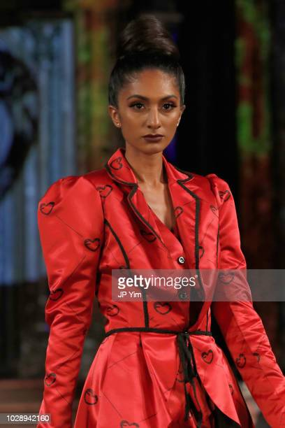 A model walks the runway during the Femata Couture show at New York Fashion Week powered by Art Hearts at The Angel Orensanz Foundation on September...