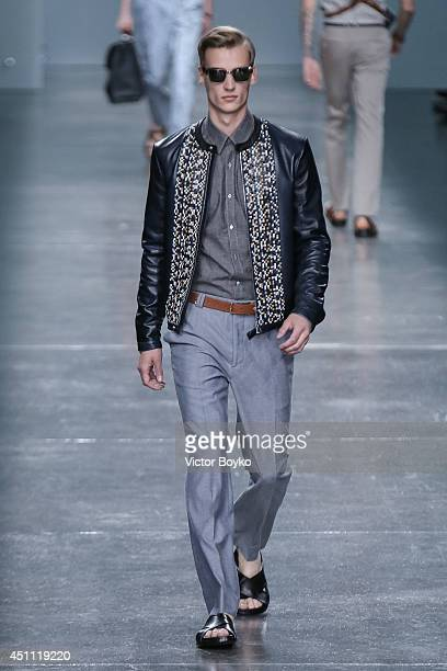 A model walks the runway during the Fendi show as part of Milan Fashion Week Menswear Spring/Summer 2015 on June 23 2014 in Milan Italy