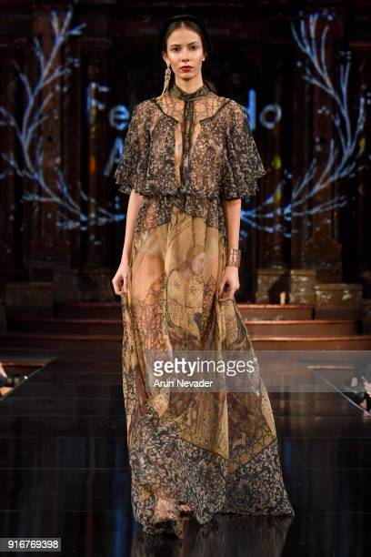 A model walks the runway during the Fernando Alberto Atelier presentation at New York Fashion Week Powered by Art Hearts Fashion NYFW at The Angel...