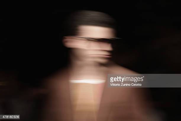 A model walks the runway during the Ferragamo show as part of Milan Men's Fashion Week Spring/Summer 2016 on June 21 2015 in Milan Italy
