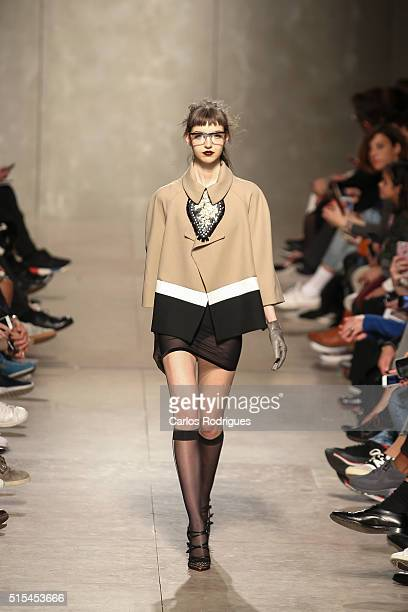 A model walks the runway during the Filipe Faisca show on Lisboa Fashion Week Autumn/Winter 2016/2017 in Lisbon on March 13 2016 in Lisbon Portugal