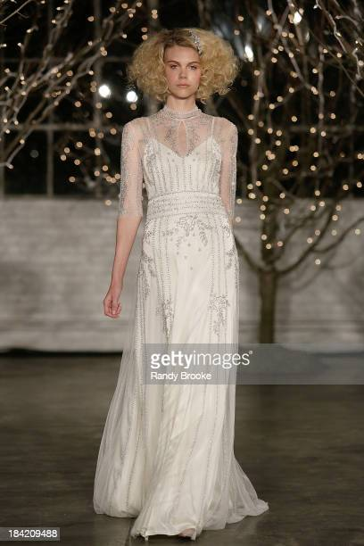 A model walks the runway during the finale at the Jenny Packham Fall 2014 Bridal collection show 25th anniversary reception on October 11 2013 in New...