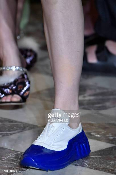 A model walks the runway during the finale of the Miu Miu 2019 Cruise Collection Show at Hotel Regina on June 30 2018 in Paris France