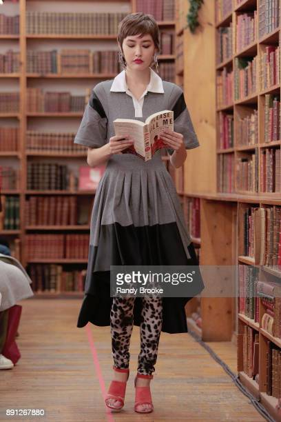 A model walks the runway during the finale where all the models hold and check out a book at Koche PreFall 2018 Runway Show at Strand Bookstore on...