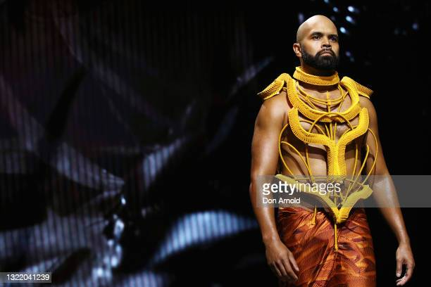 Model walks the runway during the First Nations Fashion + Design show during Afterpay Australian Fashion Week 2021 Resort '22 Collections at...