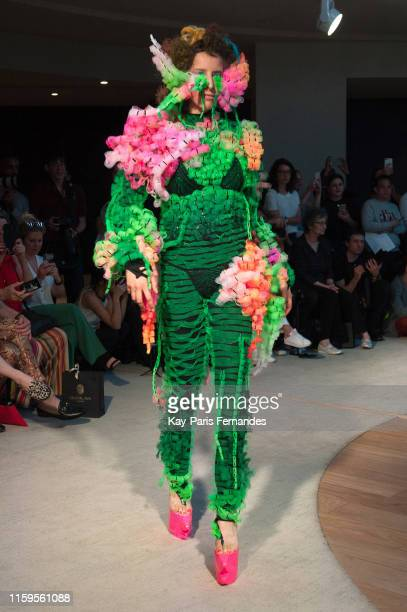 A model walks the runway during the Flora Miranda Haute Couture Fall/Winter 2019 2020 show as part of Paris Fashion Week on July 01 2019 in Paris...