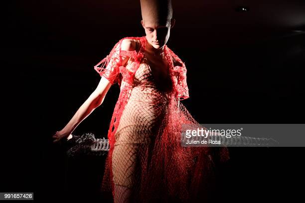 A model walks the runway during the Flora Miranda Haute Couture Fall Winter 2018/2019 show as part of Paris Fashion Week on July 4 2018 in Paris...
