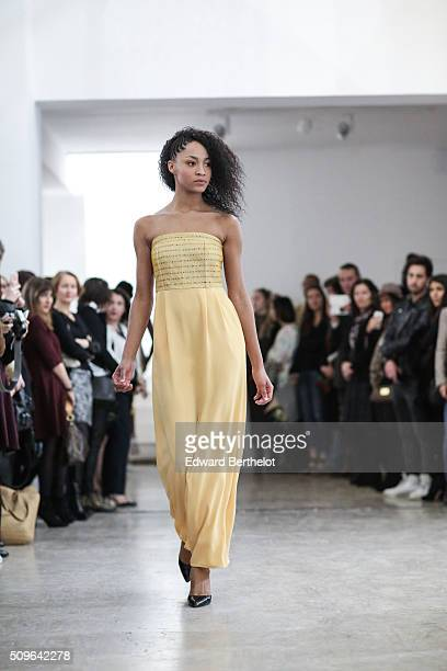 A model walks the runway during the Floriane Fosso Fall Winter 2016/2017 show on February 11 2016 at Galerie Joseph in Paris France