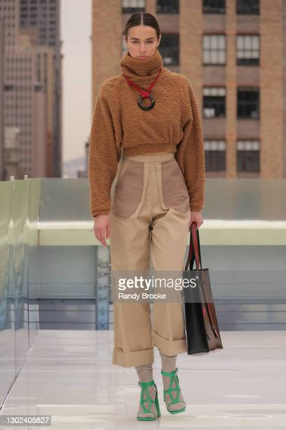 Model walks the runway during the Flying Solo Fashion show at NYFW 2021 on February 13, 2021 in New York City.