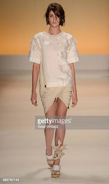 A model walks the runway during the Forum show at Sao Paulo Fashion Week Spring Summer 2014/2015 at Parque Candido Portinari on April 3 2014 in Sao...