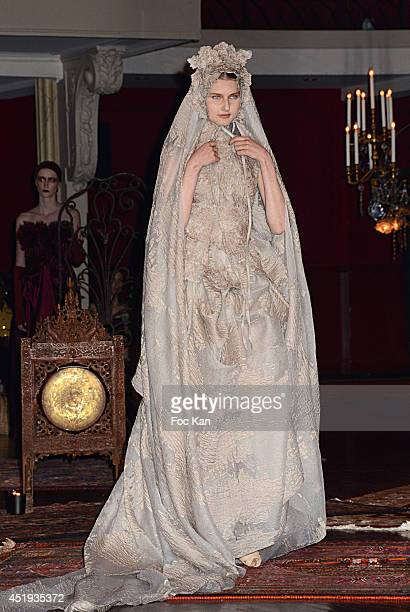 Model walks the runway during the Frank Sorbier show as part of Paris Fashion Week - Haute Couture Fall/Winter 2014-2015. Held at Salle Wagram on...