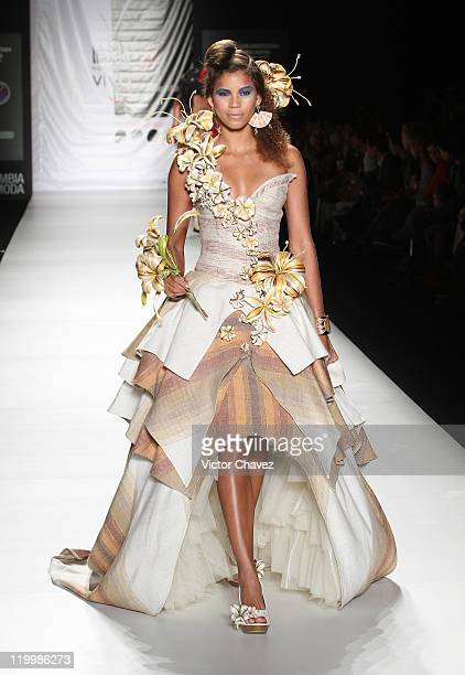 A model walks the runway during the Fundacion Universitaria Del Area Andina show on day two of Colombiamoda 2011 at Plaza Mayor on July 26 2011 in...