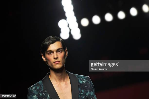 A model walks the runway during the Garcia Madrid show at Mercedes Benz Fashion Week Madrid Spring/Summer 2019 on July 10 2018 in Madrid Spain
