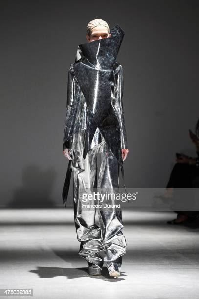 Model walks the runway during the Gareth Pugh show as part of the Paris Fashion Week Womenswear Fall/Winter 2014-2015 on February 26, 2014 in Paris,...