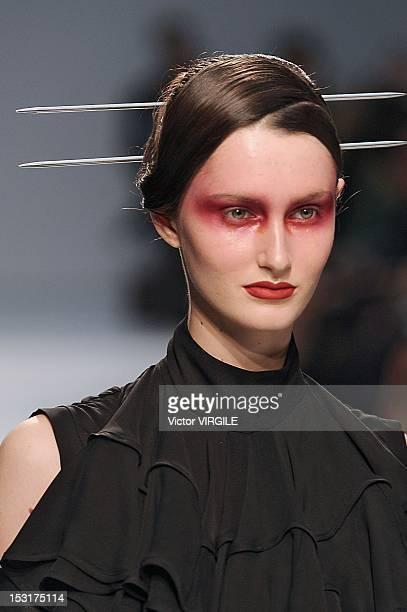 Model walks the runway during the Gareth Pugh Spring / Summer 2013 show as part of Paris Fashion Week at Palais De Tokyo on September 26, 2012 in...