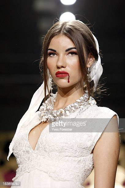A model walks the runway during the General Defile By Dom Stilya at The Youth Art Palace on October 9 2012 in Tashkent Uzbekistan