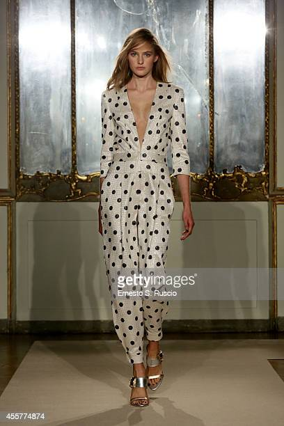 A model walks the runway during the Genny Show as part of Milan Fashion Week Womenswear Spring/Summer 2015 on September 20 2014 in Milan Italy