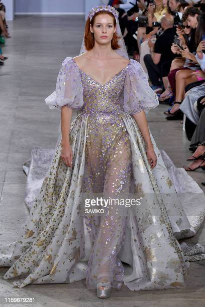 A model walks the runway during the Georges Chakra Haute Couture Fall/Winter 2019 2020 show as part of Paris Fashion Week on July 01 2019 in Paris...