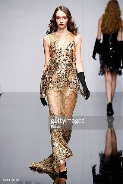A model walks the runway during the Georges Chakra Haute Couture Fall/Winter 20162017 show as part of Paris Fashion Week on July 5 2016 in Paris...