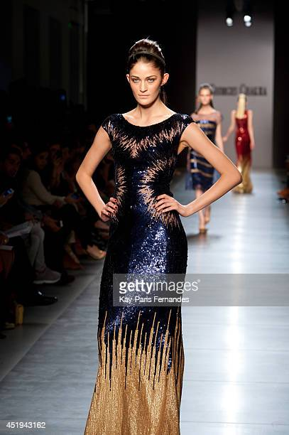 A model walks the runway during the Georges Chakra show as part of Paris Fashion Week Haute Couture Fall/Winter 20142015 at on July 9 2014 in Paris...