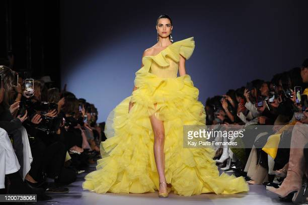 A model walks the runway during the Georges Hobeika Haute Couture Spring/Summer 2020 show as part of Paris Fashion Week on January 20 2020 in Paris...