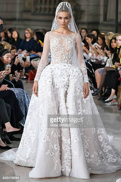 A model walks the runway during the Georges Hobeika Haute Couture Fall/Winter 20162017 show as part of Paris Fashion Week on July 4 2016 in Paris...