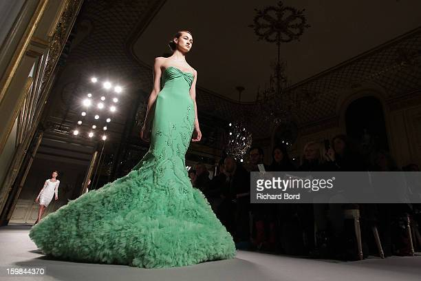 Model walks the runway during the Georges Hobeika Spring/Summer 2013 Haute-Couture show as part of Paris Fashion Week at Hotel Meurice on January 21,...