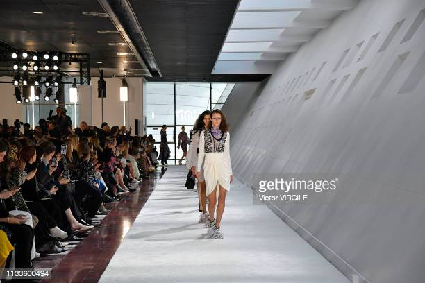 A model walks the runway during the Giambattista Valli Ready to Wear fashion show as part of the Paris Fashion Week Womenswear Fall/Winter 2019/2020...