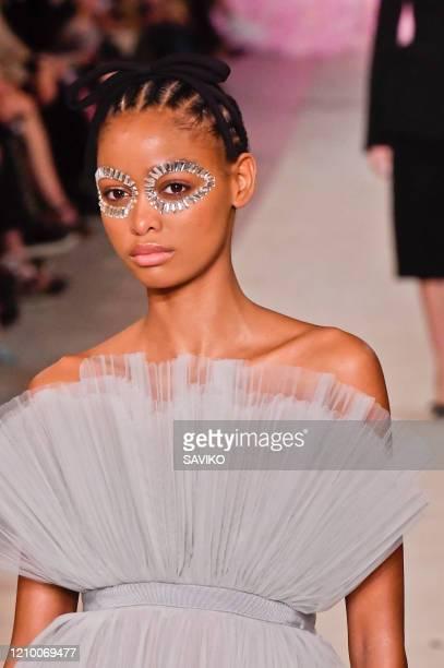 Model walks the runway during the Giambattista Valli Ready to Wear fashion show as part of the Paris Fashion Week Womenswear Fall/Winter 2020-2021 on...