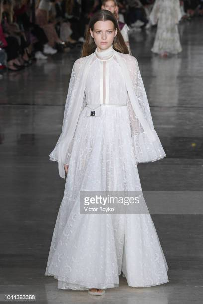 A model walks the runway during the Giambattista Valli show as part of the Paris Fashion Week Womenswear Spring/Summer 2019 on October 1 2018 in...