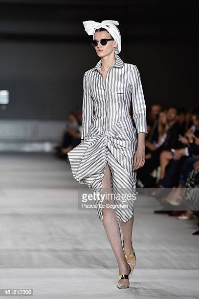 A model walks the runway during the Giambattista Valli show as part of Paris Fashion Week Haute Couture Fall/Winter 20142015 on July 7 2014 in Paris...