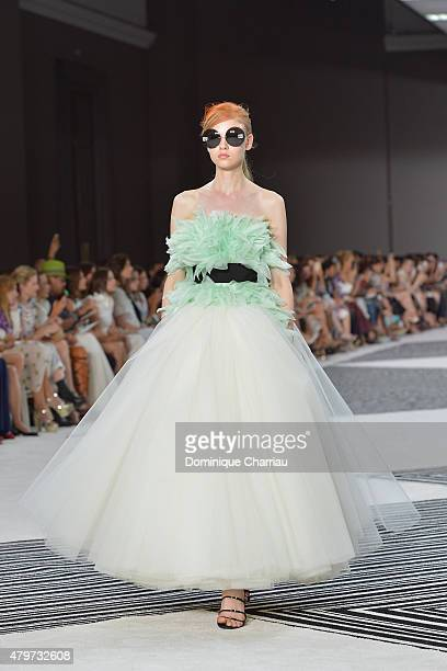 Model walks the runway during the Giambattista Valli show as part of Paris Fashion Week Haute Couture Fall/Winter 2015/2016 on July 6, 2015 in Paris,...