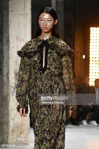 Model walks the runway during the Giambattista Valli show as part of the Paris Fashion Week Womenswear Fall/Winter 2018/2019 on March 5, 2018 in...