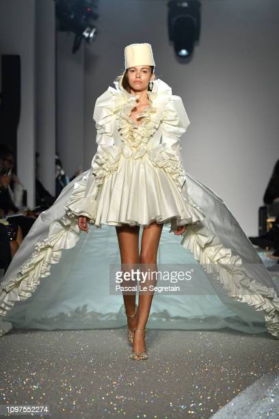 A model walks the runway during the Giambattista Valli Spring Summer 2019 show as part of Paris Fashion Week on January 21 2019 in Paris France