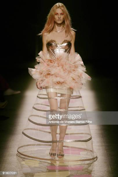 Model walks the runway during the Giles Pret a Porter show as part of the Paris Womenswear Fashion Week Spring/Summer 2010 at Palais De Tokyo on...