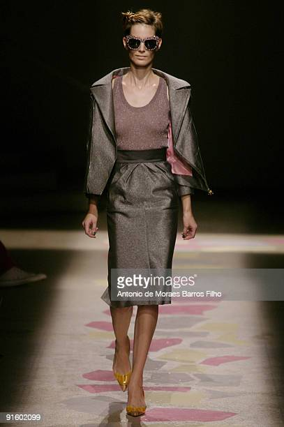 A model walks the runway during the Giles Pret a Porter show as part of the Paris Womenswear Fashion Week Spring/Summer 2010 at Palais De Tokyo on...