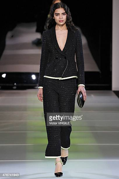 A model walks the runway during the Giorgio Armani as a part of Milan Fashion Week Womenswear Autumn/Winter 2014 on February 24 2014 in Milan Italy