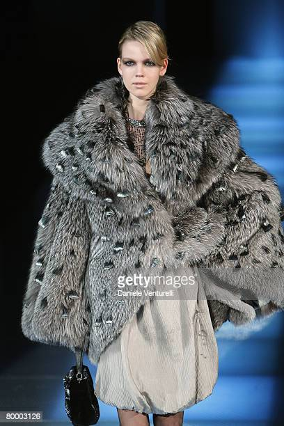 A model walks the runway during the Giorgio Armani fashion show as part of Milan Fashion Week Autumn/Winter 2008/09 on February 18 2008 in Milan Italy