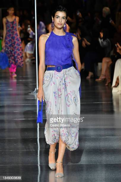 "Model walks the runway during the Giorgio Armani ""One Night Only Dubai"" fashion show at the Armani Hotel Dubai on October 26, 2021 in Dubai, United..."