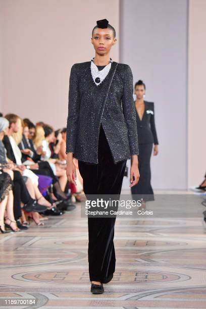 Model walks the runway during the Giorgio Armani Prive Haute Couture Fall/Winter 2019 2020 show as part of Paris Fashion Week on July 02, 2019 in...