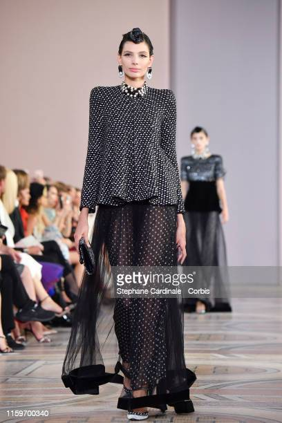 A model walks the runway during the Giorgio Armani Prive Haute Couture Fall/Winter 2019 2020 show as part of Paris Fashion Week on July 02 2019 in...