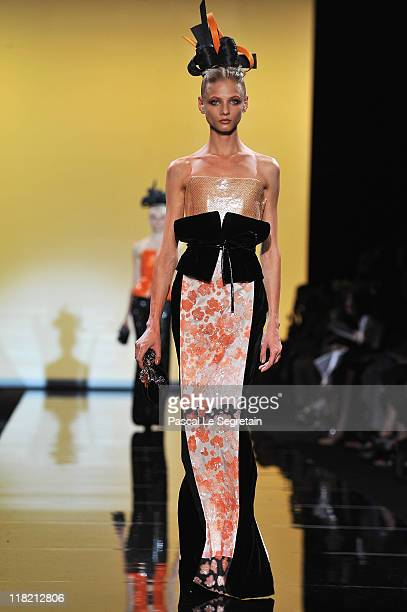 Model walks the runway during the Giorgio Armani Prive Haute Couture Fall/Winter 2011/2012 show as part of Paris Fashion Week at Palais de Chaillot...