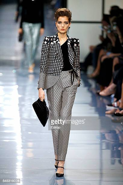 A model walks the runway during the Giorgio Armani Prive Haute Couture Fall/Winter 20162017 show as part of Paris Fashion Week on July 5 2016 in...